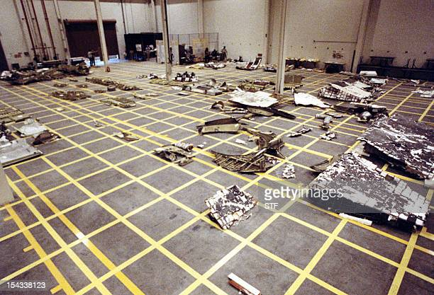 Pieces of the Space Shuttle Challenger are arranged in a hangar after being salvaged from the Atlantic Ocean where they were scattered on January 28...