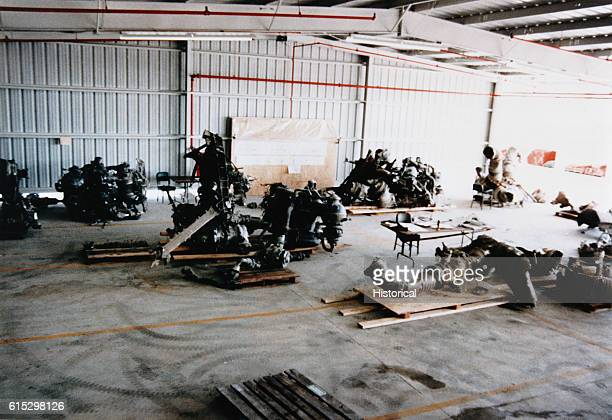 Pieces of the three main engines of the Space Shuttle Challenger recovered from the ocean floor in a storage building at Kennedy Space Center