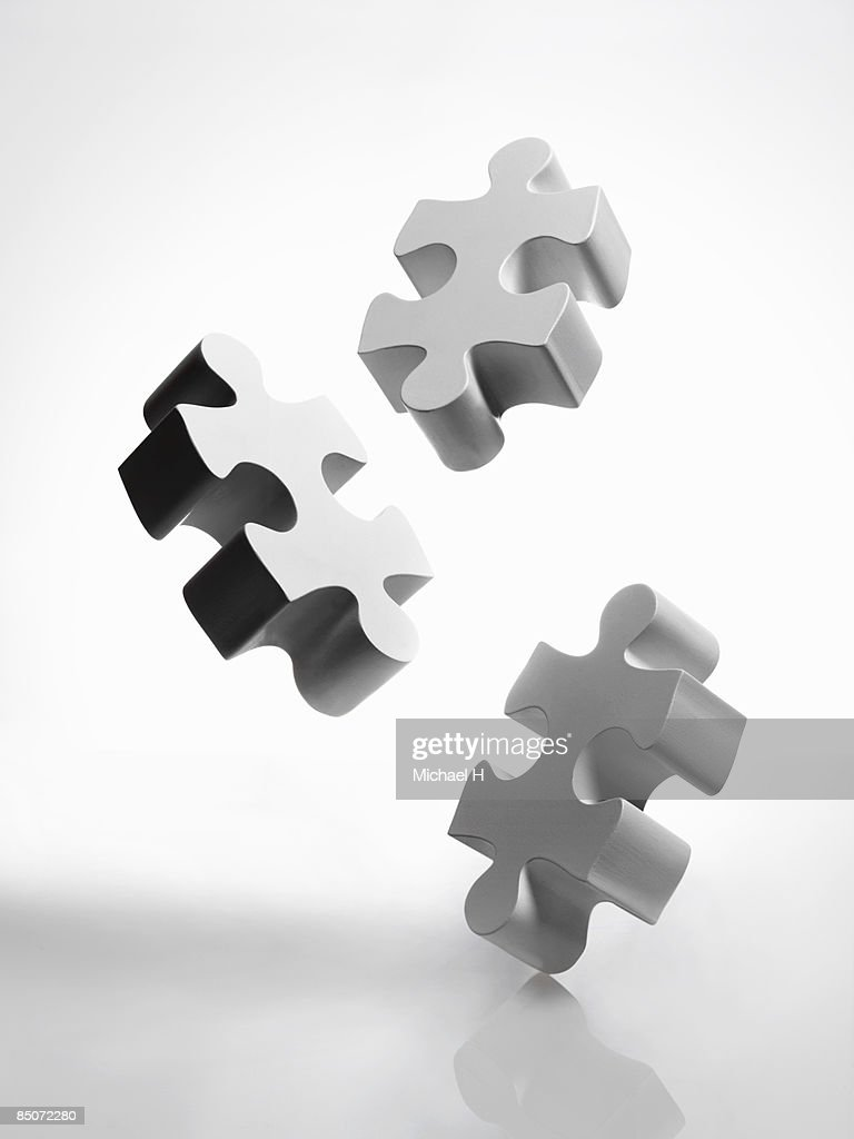 Pieces of white jigsaw puzzle : Stock Photo