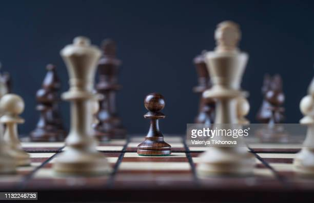 pieces on chess board - chess board stock pictures, royalty-free photos & images