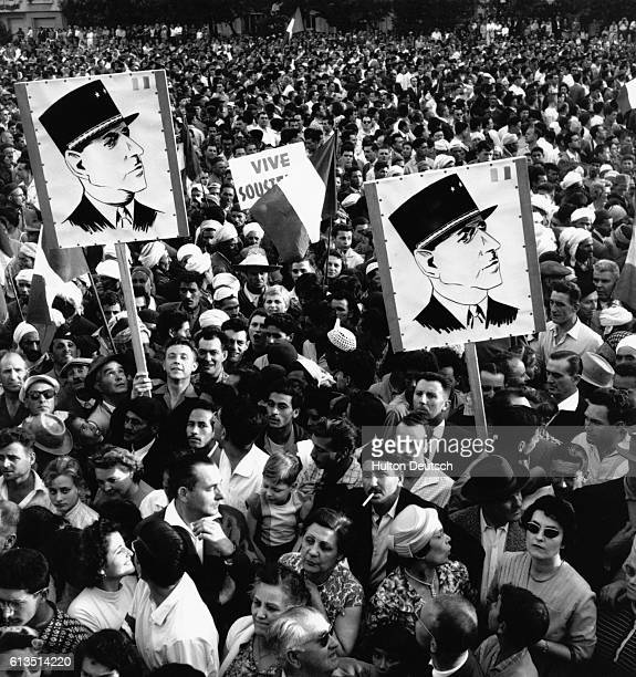 PiedsNoirs Carrying De Gaulle and Soustelle Posters in Algiers