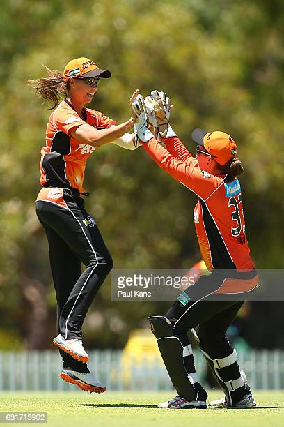 Piepa Cleary and Emily Smith of the Scorchers celebrate after dismissing Meg Lanning of the Stars during the Women's Big Bash League match between...