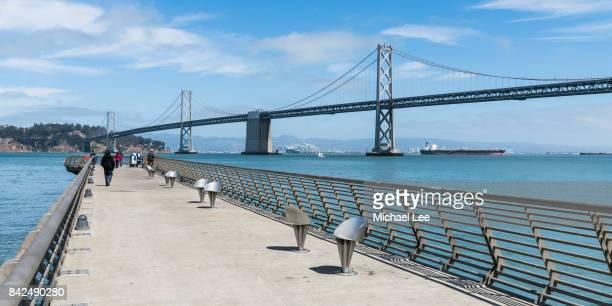 pier 14 and bay bridge - san francisco, california - bay bridge stock pictures, royalty-free photos & images
