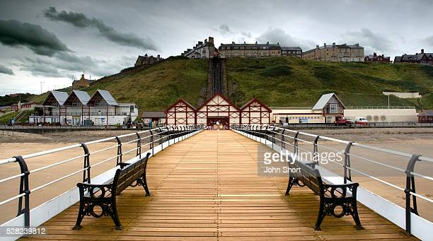 pier above beach - saltburn stock photos and pictures