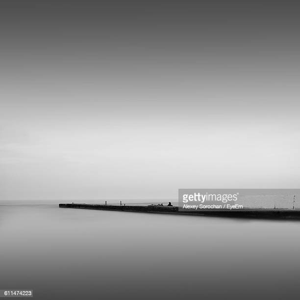 pier amidst sea against clear sky during foggy weather - ウクライナ オデッサ市 ストックフォトと画像