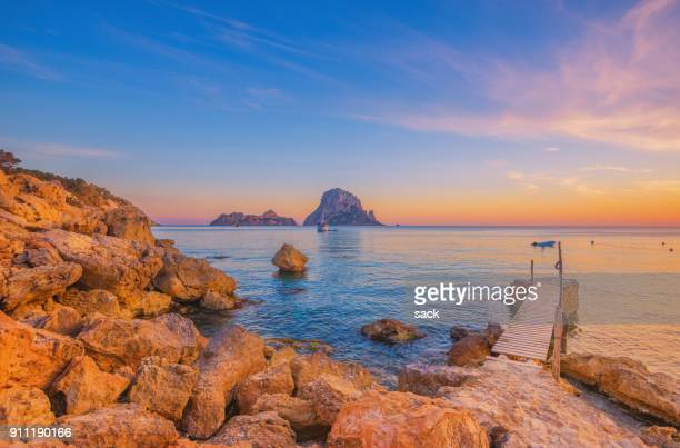 pier and beautiful landscape at cala d´hort on ibiza - ibiza island stock pictures, royalty-free photos & images