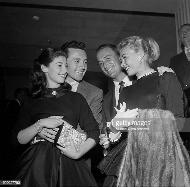 Pier Angeli and Vic Damone pose with friends during Eddie Fisher and Debbie Reynolds party at Cantors in Los AngelesCA