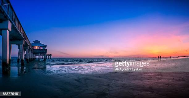pier at fort myers beach against sky at sunset - fort myers beach stock pictures, royalty-free photos & images