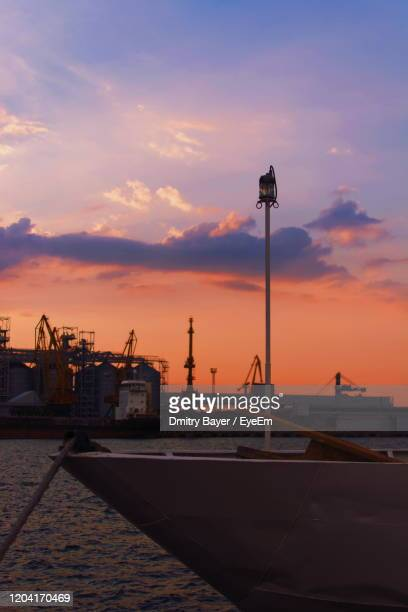 pier at harbor against sky during sunset - odessa ukraine stock pictures, royalty-free photos & images