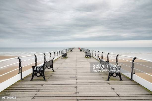 pier at saltburn-by-the-sea, north yorkshire, england - symmetry stock pictures, royalty-free photos & images