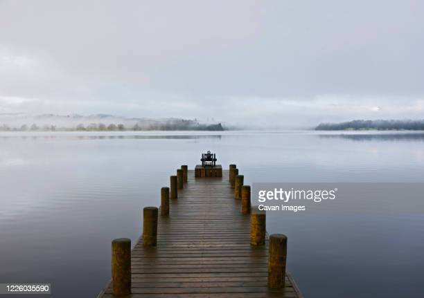 pier at still lake in the british lake district - english lake district stock pictures, royalty-free photos & images