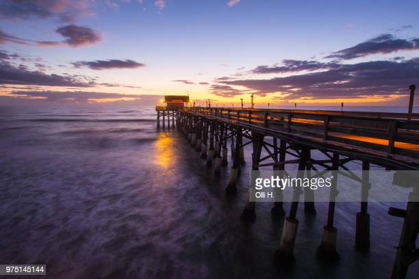 pier at sunrise in cocoa beach, brevard county, florida, usa - cocoa beach stock pictures, royalty-free photos & images