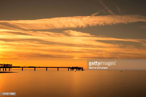 pier at sunset - bernd schunack stock pictures, royalty-free photos & images