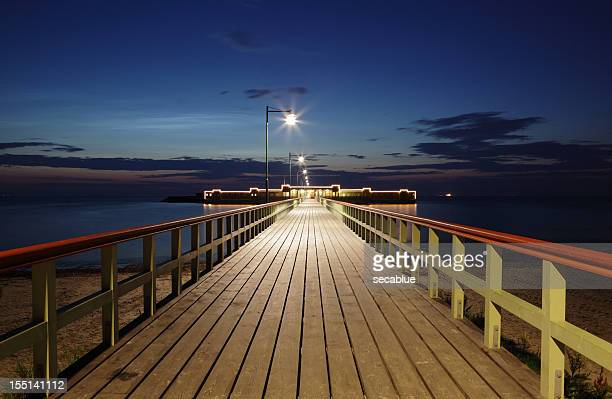 pier at sunset - malmo stock pictures, royalty-free photos & images