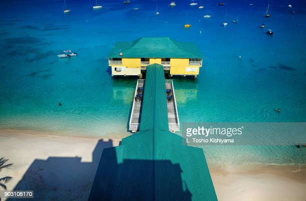 pier at the beach in barbados - bridgetown barbados stock photos and pictures