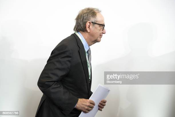 Pier Carlo Padoan Italy's finance minister leaves the stage following an event to mark World Savings Day at the Italian Banking Association in Rome...