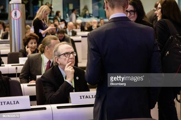 Pier Carlo Padoan Italy's finance minister left speaks with attendees during the European Commission's financial framework conference in Brussels...