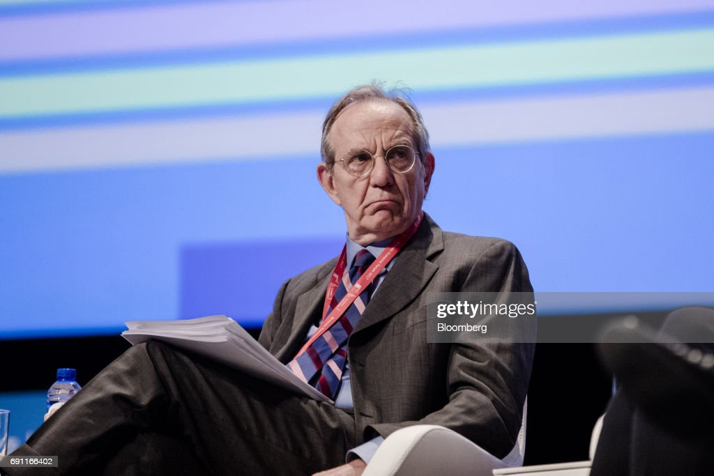 Pier Carlo Padoan, Italy's finance minister, looks on during the Brussels Economic Forum in Brussels, Belgium, on Thursday, June 1, 2017. It may take the U.K. as long as five years to leave the European Union, with the process set to do major harm to both parties, billionaire investor George Soros said, urging the worlds biggest trading bloc to avoid penalizing Britain and instead focus on reforming itself. Photographer: Marlene Awaad/Bloomberg via Getty Images