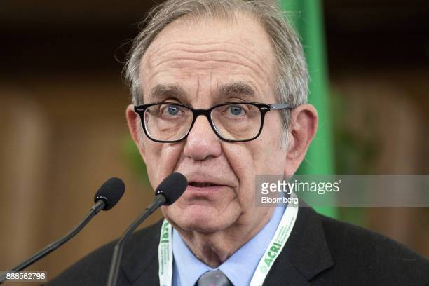 Pier Carlo Padoan Italy's finance minister speaks during an event to mark World Savings Day at the Italian Banking Association in Rome Italy on...