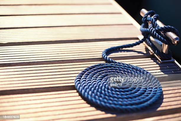 pier cleat and a mooring rope - bollard stock photos and pictures