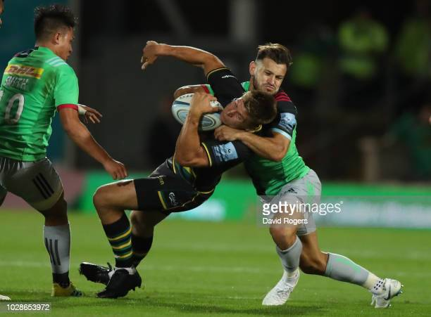Pier Francis of Northampton is high tackled by Danny Care resulting in a penalty during the Gallagher Premiership Rugby match between Northampton...
