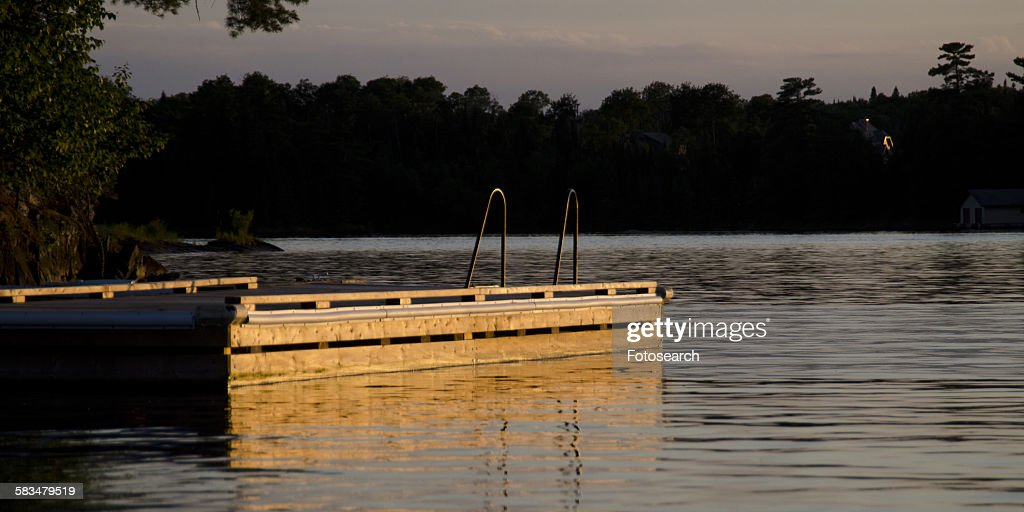 Pier in a lake : Stock Photo