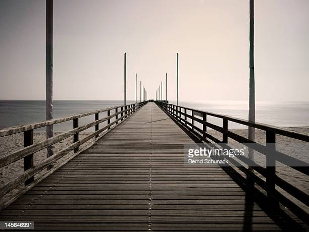 pier in central perspective - bernd schunack stock photos and pictures