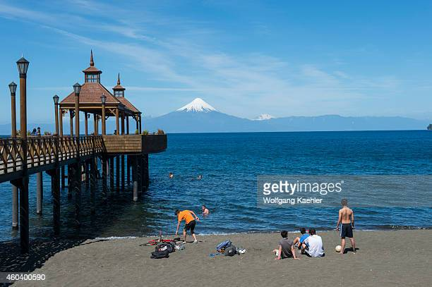 Pier in Frutillar a small town on Lake Llanquihue in the Lake District near Puerto Montt Chile with Osorno Volcano in background
