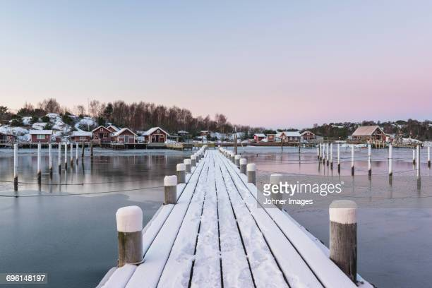 Pier in harbor covered with snow