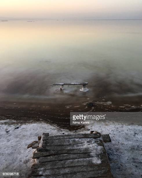 a pier in lake urmia - lake urmia foto e immagini stock