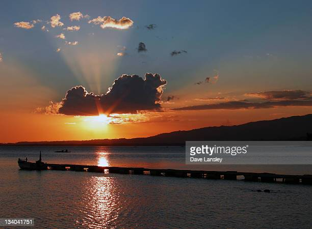 pier in sea at sunset - negros oriental stock pictures, royalty-free photos & images