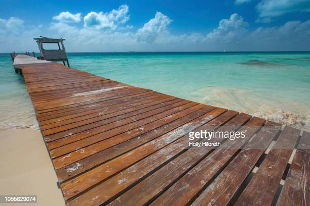 pier in the caribbean - temptation island stock photos and pictures