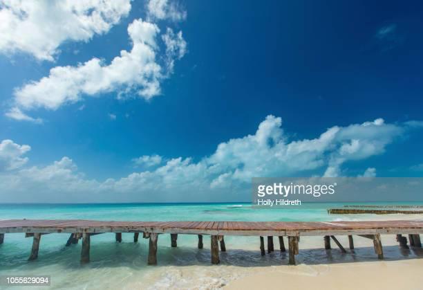 pier in the caribbean - jetty stock pictures, royalty-free photos & images