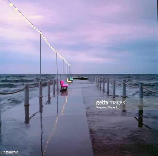 pier in the rain - odessa ukraina bildbanksfoton och bilder