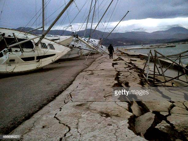 A pier is damaged in the port of Lixouri on the Greek island of Cephalonia in the Ionian Sea on Fanuary 3 after a strong 61 magnitude earthquake...