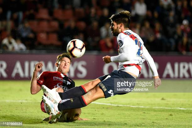 Pier Larrauri of Peruvian Deportivo Municipal vies for the ball with Guillermo Ortiz of Argentinian Colon during a Copa Sudamericana 2019 football...