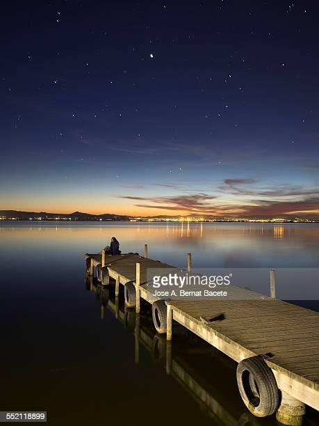 pier of wood with a young pair. - partire bildbanksfoton och bilder