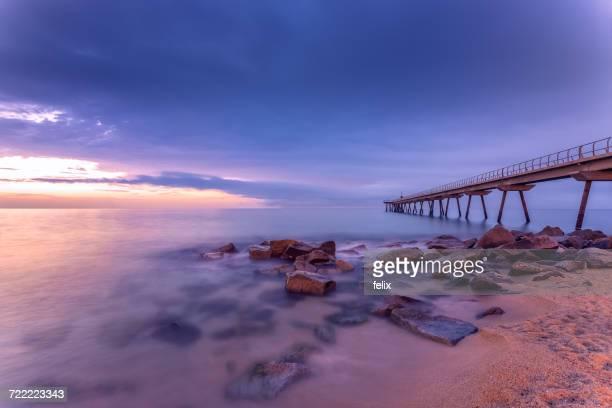 Pier on beach, Badalona, Spain