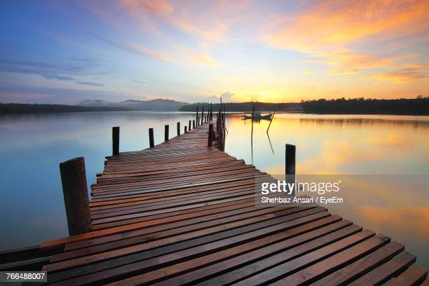 Pier On Lake Against Sky During Sunset