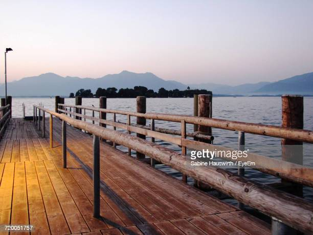 pier on lake - sabine hauswirth stock pictures, royalty-free photos & images