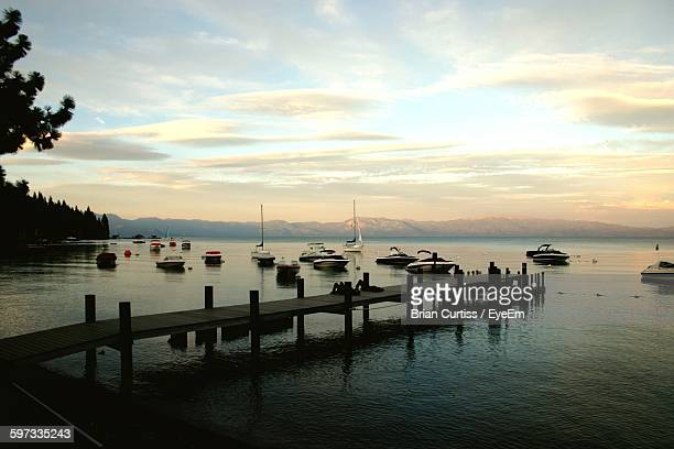 pier on lake tahoe against cloudy sky - westchester county stock photos and pictures