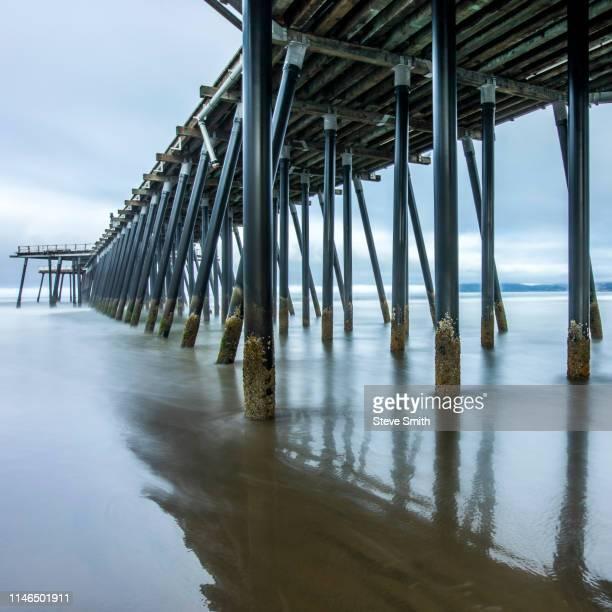 pier on pismo beach, california, usa - ピスモビーチ ストックフォトと画像