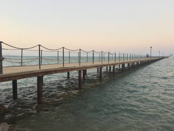 Pier On Sea Against Clear Sky During Sunset