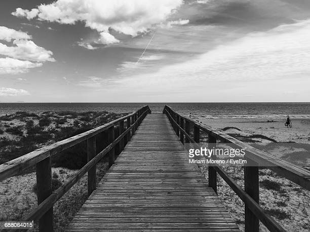 pier on sea against cloudy sky - disabled access stock photos and pictures