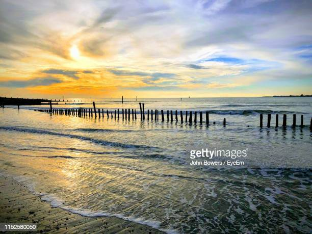 pier on sea against sky during sunset - sussex stock pictures, royalty-free photos & images