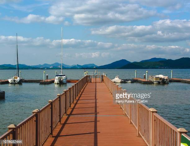 pier on sea against sky - ningbo stock pictures, royalty-free photos & images