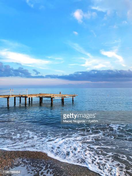 pier on sea against sky - belek stock pictures, royalty-free photos & images