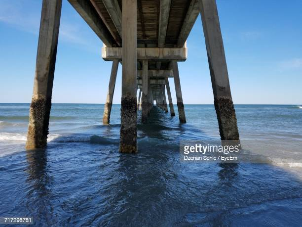 pier on sea against sky - jacksonville beach stock pictures, royalty-free photos & images