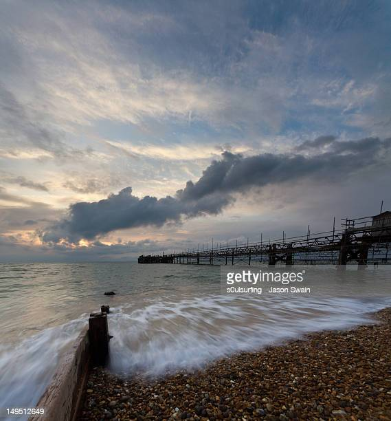 pier on sea at sunset - s0ulsurfing stock pictures, royalty-free photos & images