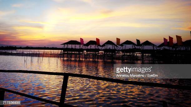 pier on sea at sunset - malabon stock pictures, royalty-free photos & images